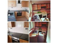 Kitchen fitter installation worktop joint West Midlands UK HQ assembly job