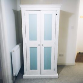 Cute solid pine wardrobe. Painted white and teal.