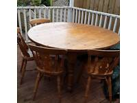 Circular Pine table and 4 chairs