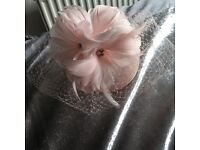 Brand new woman's fascinator never been worn, label is still attached.