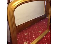 Gold coloured fire place mirror