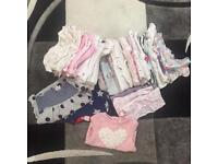 Assortment of baby girl clothing open to offers