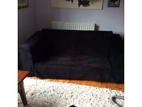 Luscious comfy black chenille sofa with loose covers.