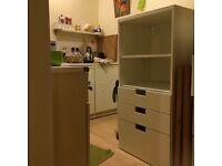 White storage unite with shelf and 3 drawers