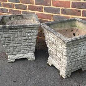 2 garden concrete planters on plinths