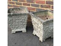 2 garden concrete planters on plinths