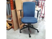 Konig +Neurath blue fabric operator chair with flat armrests