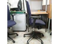 Konig + Neurath dark blue fabric operator chair with oval armrests