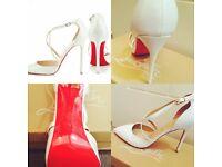 White patent Christian Louboutin Heels. Size 6. Brand New.