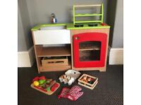Children's play kitchen with fruit and veg