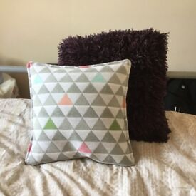Assorted throw pillows for bedroom or sofa