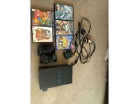 PS2 with games, eye toy, power cable, tv cable, scart, extension, 2 x controllers & memory card.