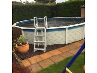 18ft diameter x 4ft deep swimming pool with sand filter and pump