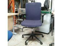 Konig + Neurath dark blue fabric operator chair with disc and rectangular armrests