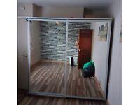 Mirrored sliderobe with drawers