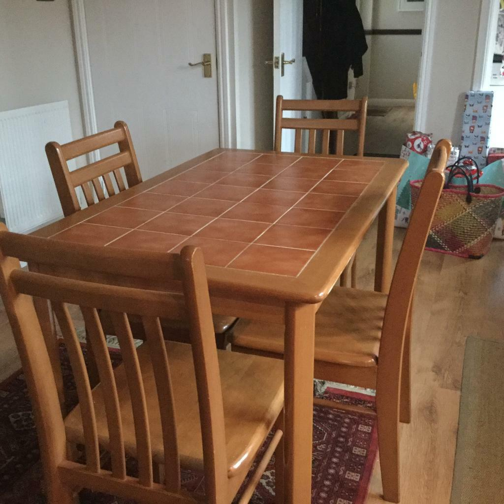 Dining room / kitchen table with four wooden