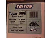 Triton electric power shower still boxed 9.5 watt, cost £120.00 will accept £40