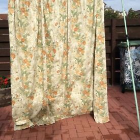Two pairs of floral lined curtains with tie backs 7' drop 9' wide very good condition