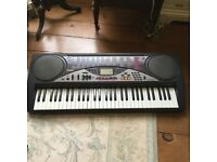 Casio Keyboard complete with box, power cable carry case and music stand