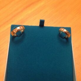 MATCHING YELLOW AND WHITE GOLD RINGS INSET WITH DIAMONDS