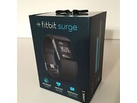 Brand New Fit Bit Surge - Unwanted Gift - Swap for Amazon Echo