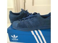 Blue Suede Adidas Superstars size 6.