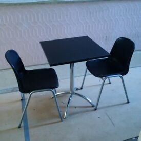 small black table with two chairs can deliver