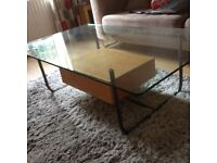 Coffee table, glass topped.