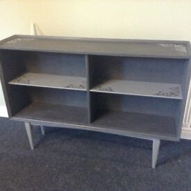 Long slim bookshelf in grey with shabby chic detail