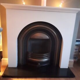 Contemporary stylish fire surround with painted woiden mantel and black granite hearth