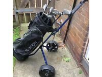 Slazenger golf clubs with bag and trolley.
