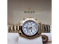 Gold Rolex Daytona with White Face Automatic Sweeping Hands