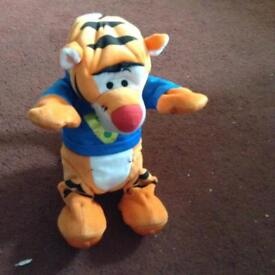 Childs bouncing/rolling tigger toy