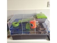 Hamster cage as new with a tame Syrian hamster