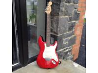 Squier Strat Electric Guitar and Marshall Amplifier