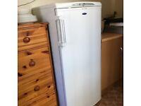 white upright freezer