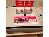Canon all-in-one printer, new cartridges and cd for drive.