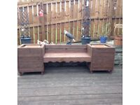 Garden planter seat box with flower boxes inserted ready for planting