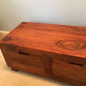 Occasional table made from dark stained sheesham wood, with 3 drawers.