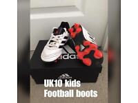 Kids size 10 football boots