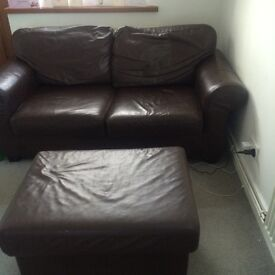 2 seater brown leather sofa and puffet