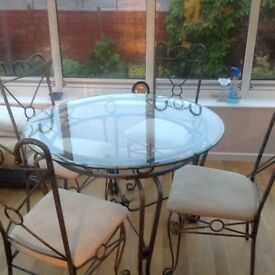 Glass topped wrought iron Dining Table & 4 matching chairs