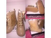Spanish lace up boots