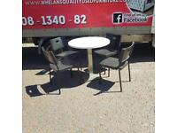 Heavy cast iron table and 4 chairs £45(wee mark on table see pic,hence price)