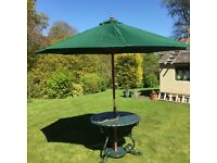 Very large Green garden umbrella with cover and ornate sat iron base