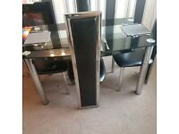 Black dining table and 4 chairs set. Glass table.