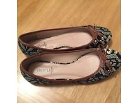 Women's size 5 ballet shoes black and brown pattern worn once