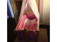 Pine rocking crib with drapes