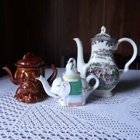Two ornamental teapots and one coffee pot