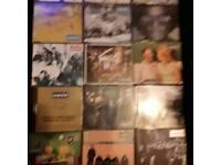 Oasis cds in metal box